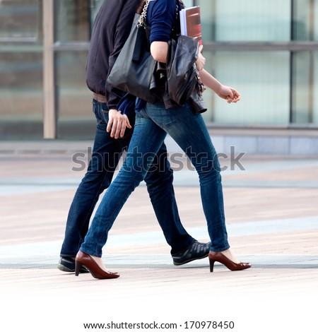 Running man and woman. Urban scene. - stock photo