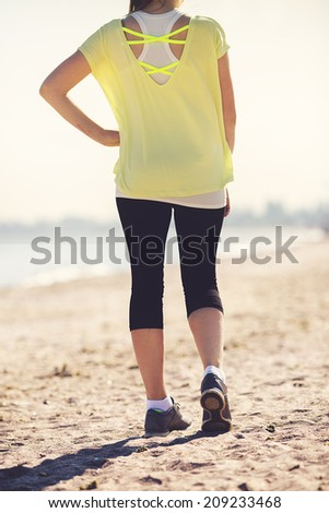 running on beach closeup on shoe. woman fitness sunrise jog workout wellness concept. - stock photo