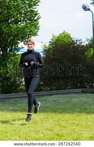 Running on the grass is more pleasant - stock photo
