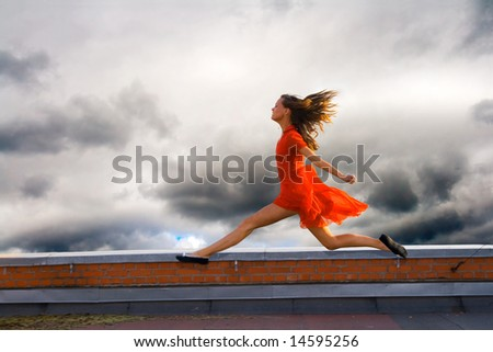 Running on the roof of a young woman - stock photo