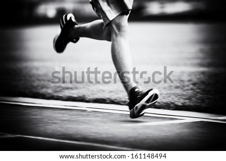 Running on the track black and white - stock photo