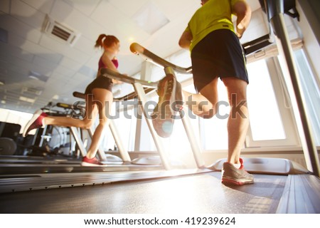 Running on treadmills - stock photo