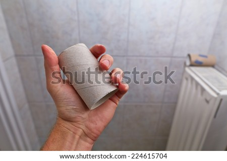 Running out of toilet paper in the bathroom - stock photo