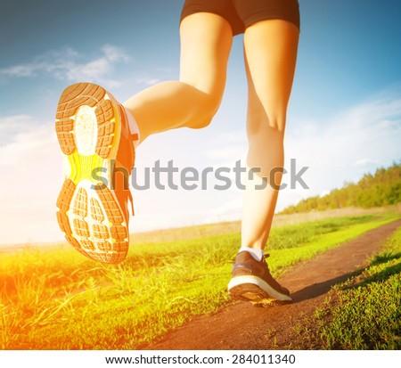 running outdoors - stock photo