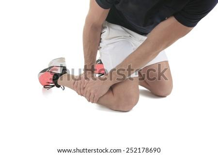 Running physical injury, leg muscle pain in studio - stock photo