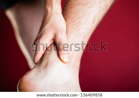 Running physical injury, leg pain. Runner sore body after exercising. Man having pain in ankle or joint. - stock photo