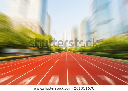 running race line in modern city road with cityscape as background,Modern business competition concept. - stock photo