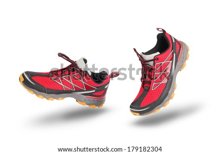 Running red sport shoes isolated on white - stock photo