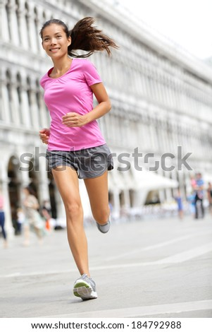 Running runner woman jogging in Venice. Female sport athlete mixed race Asian Caucasian woman training on travel vacation as tourist on Piazza San Marco Square, Venice, Italy, Europe. - stock photo