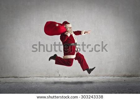 Running Santa Claus - stock photo