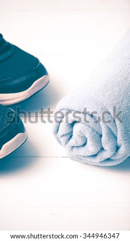 running shoes and towel on white wood table vintage style