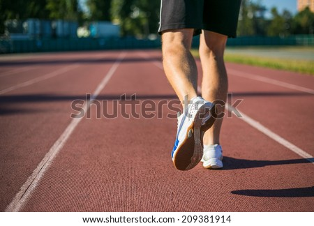 Running shoes, feet and legs. Young men running.