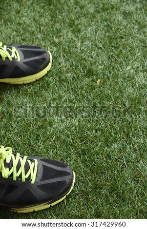 Running shoes on green grass. - stock photo