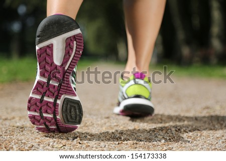 Running shoes while jogging, sports, training or workout - stock photo