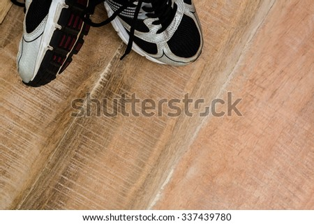 Running shoes with copy space on wooden table