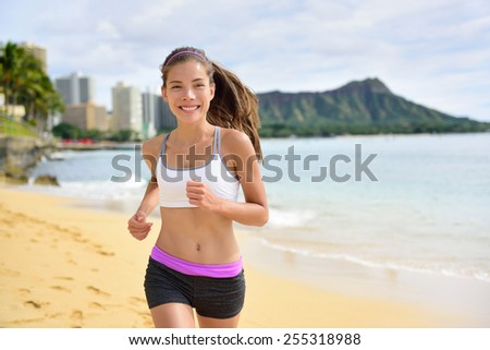 Running sport fitness woman jogging on beach run. Female athlete runner jogger training living healthy active exercise lifestyle exercising outdoor on Waikiki Beach, Honolulu, Oahu, Hawaii, USA.  - stock photo