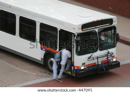 running to catch the bus - stock photo
