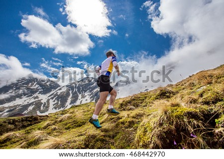 running to the top. vertical kilometer runner