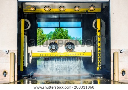 Running Touchless Carwash Photo. Car Cleaning in the Car Wash. - stock photo
