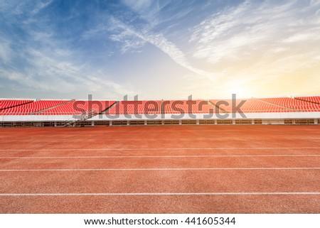 running track and bleachers at the stadium - stock photo