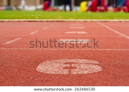 Running track and number lanes, soft focus and blur - stock photo