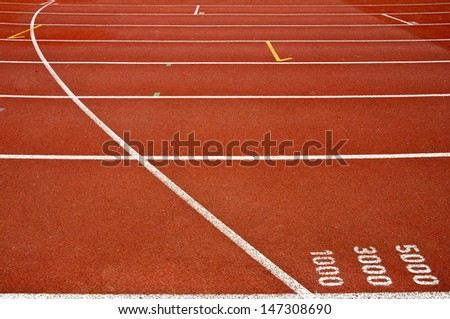 Running track at one, three, five thousand meter - stock photo