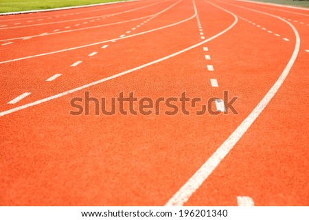 Running track for athletics - stock photo