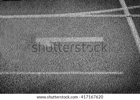 Running track for the athletes background. Black and white. Number one - stock photo
