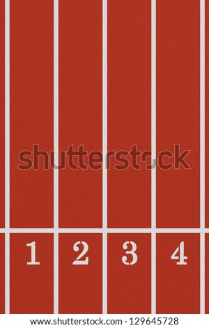Running track from a bird's perspective showing the first four lanes - stock photo