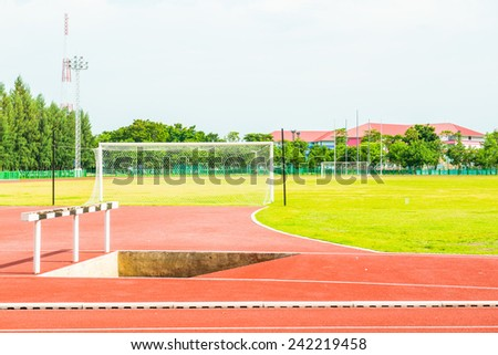 Running track, hurdle and goal in Thailand. - stock photo