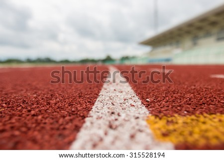 Running track in stadium. - stock photo