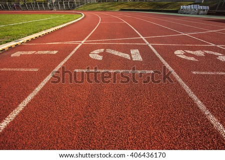 Running track in stadium with lane numbers - stock photo