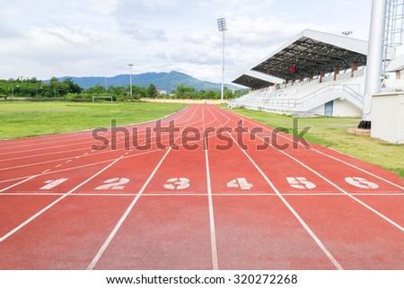 Running track inside the stadium in morning time - stock photo