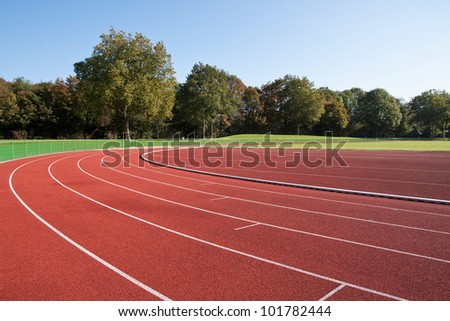 Running track lines on a sunny day