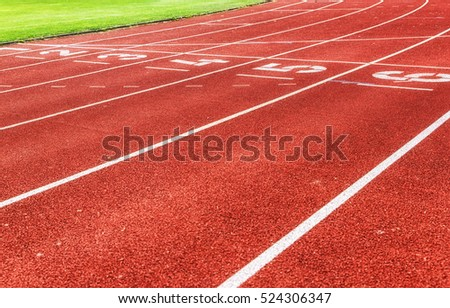 Running track lines with green grass