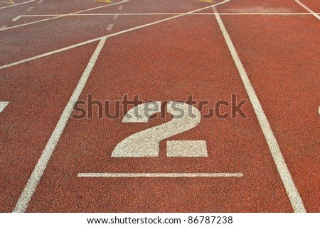 Running track number at sport stadium.