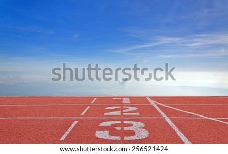 running track number standard red color under the blue sky - stock photo