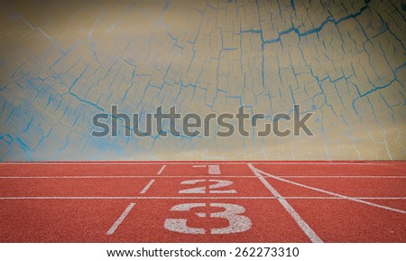 running track number standard red color under wood and blue sky background - stock photo
