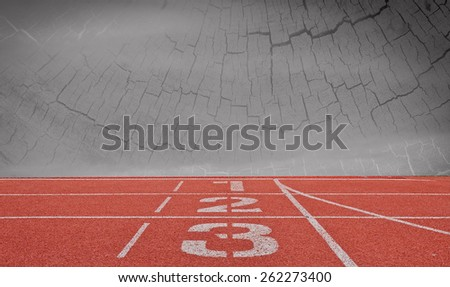 running track number standard red color under wood and dark  sky background - stock photo
