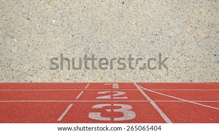 running track number standard red color with sand beach background - stock photo