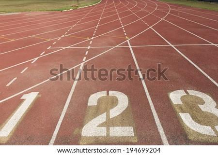 Running track numbers in stadium - stock photo