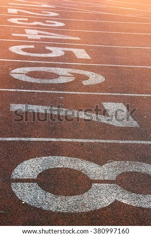 Running track numbers in the stadium - stock photo