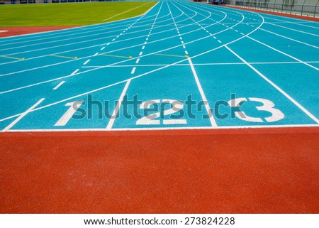 Running track numbers one two three in stadium - stock photo