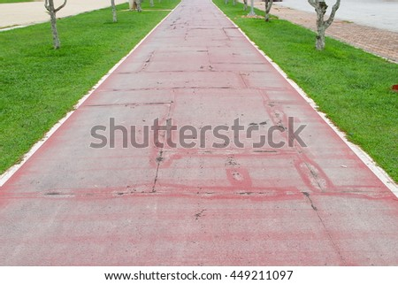 Running track  old  rubber coating shabby and cracked surface, select focus front with shallow depth of field.