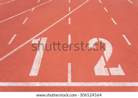Running track on sport stadium number one and two - stock photo