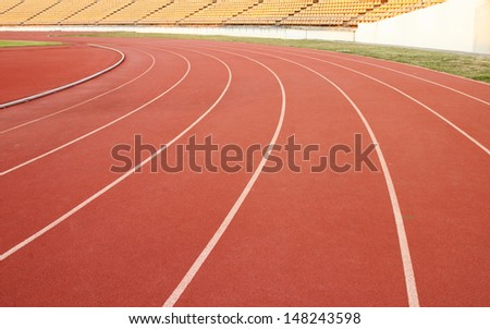 running track rubber standard red color in aports stadium - stock photo
