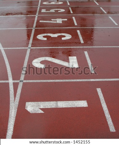 Running track shot from the start line with numbered lanes showing numbered from 1 to 6