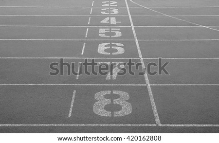 Running track. Start and finish point of running track without number one. Black and white color. Abstract photo.
