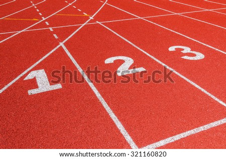 Running track texture with lane numbers - stock photo