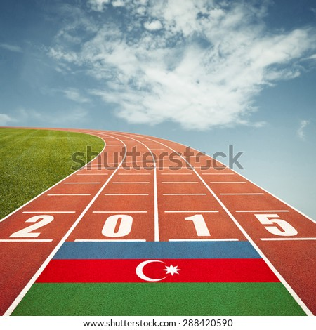 Running track with Azerbaijan flag and number 2015 - stock photo